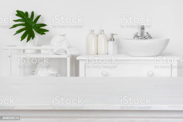 Wooden table top with blurred bathroom interior for product display picture id946035210?b=1&k=6&m=946035210&s=612x612&h=mk75wo6phbhxhaupu trugmayaywf ylpexfxynkgw4=