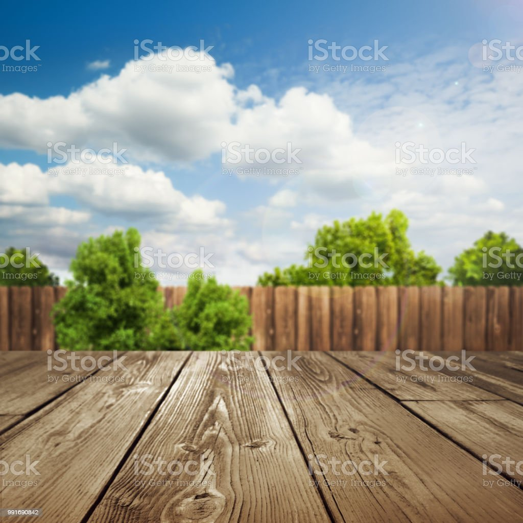 wooden table top with blurred outdoor backyard background stock photo