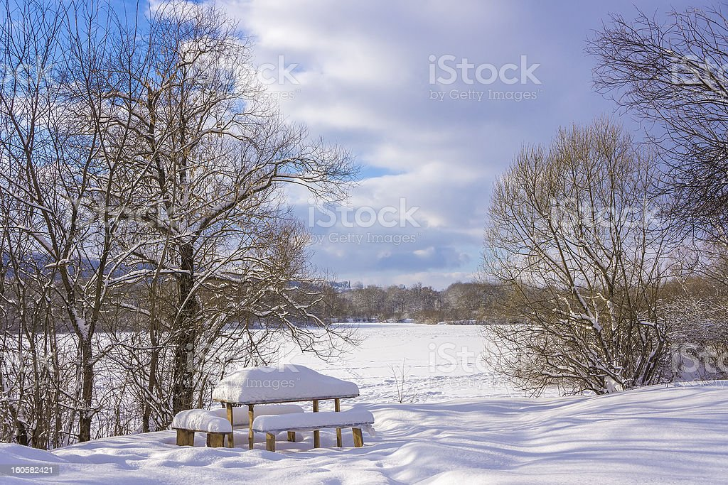 Wooden table under snow on a frozen lake. royalty-free stock photo