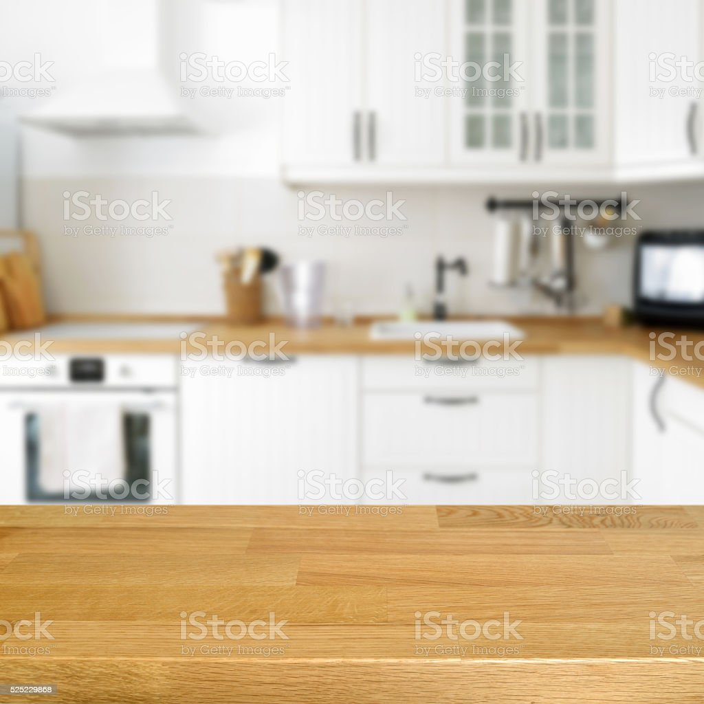 Kitchen Background Design: Wooden Table With A Blurred Kitchen Background Stock Photo