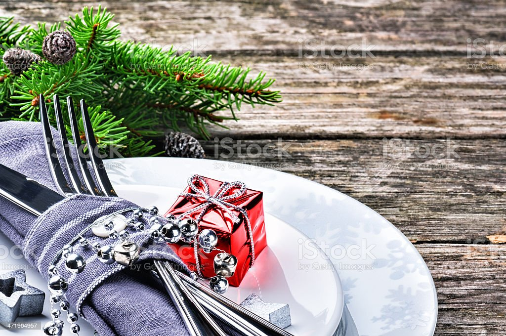 Wooden table with a Christmas table setting stock photo