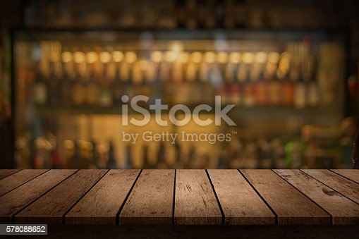 istock wooden table with a view of blurred beverages bar backdrop 578088652