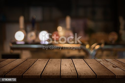 istock wooden table with a view of blurred beverages bar backdrop 578088720