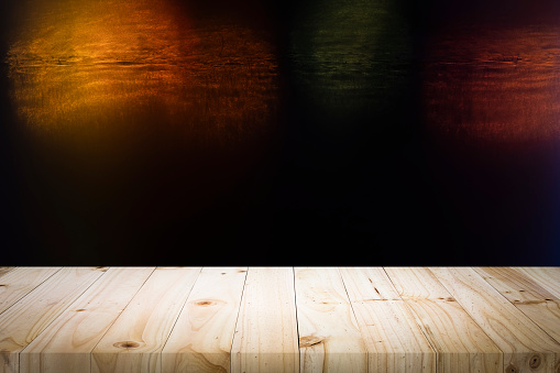 498688230 istock photo Wooden table with blur night bokeh background. 1137725138