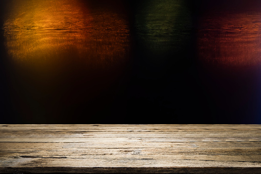 498688230 istock photo Wooden table with blur night bokeh background. 1137725139