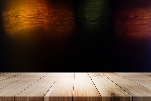 498688230 istock photo Wooden table with blur night bokeh background. 1137725140