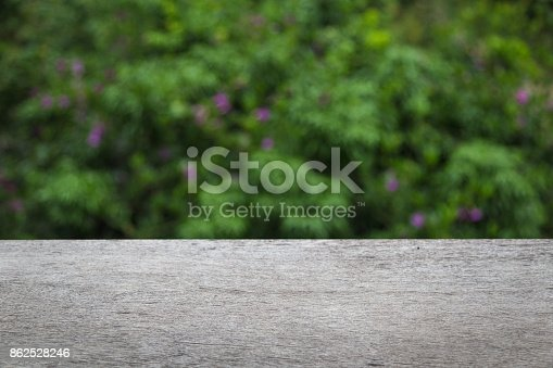 641254964 istock photo wooden table with blurred city park on background 862528246