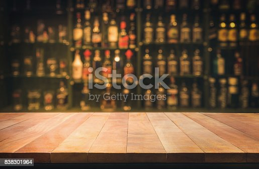 istock wooden table with blurred counter bar and bottles Background 838301964