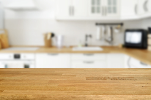 Wooden Table With Blurred Kitchen Background Stock Photo ...