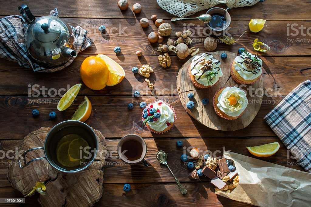wooden table with cupcakes stock photo
