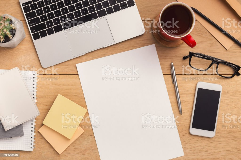 Wooden table with empty paper top view stock photo