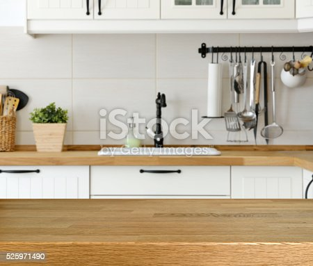 istock Wooden table with kitchen counter and sink background 525971490