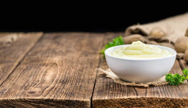 Wooden table with Mashed Potatoes (selective focus) stock photo