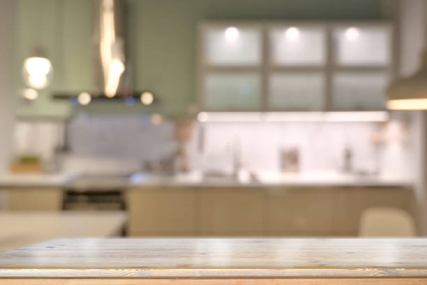 wooden table with modern kitchen room background. - kitchen counter imagens e fotografias de stock
