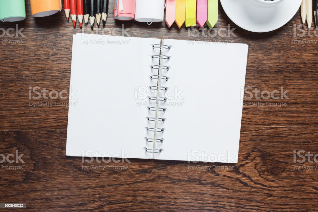 Wooden table with notepad and coffee - Royalty-free Above Stock Photo