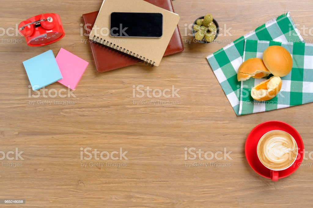 Wooden table with office supplies. royalty-free stock photo