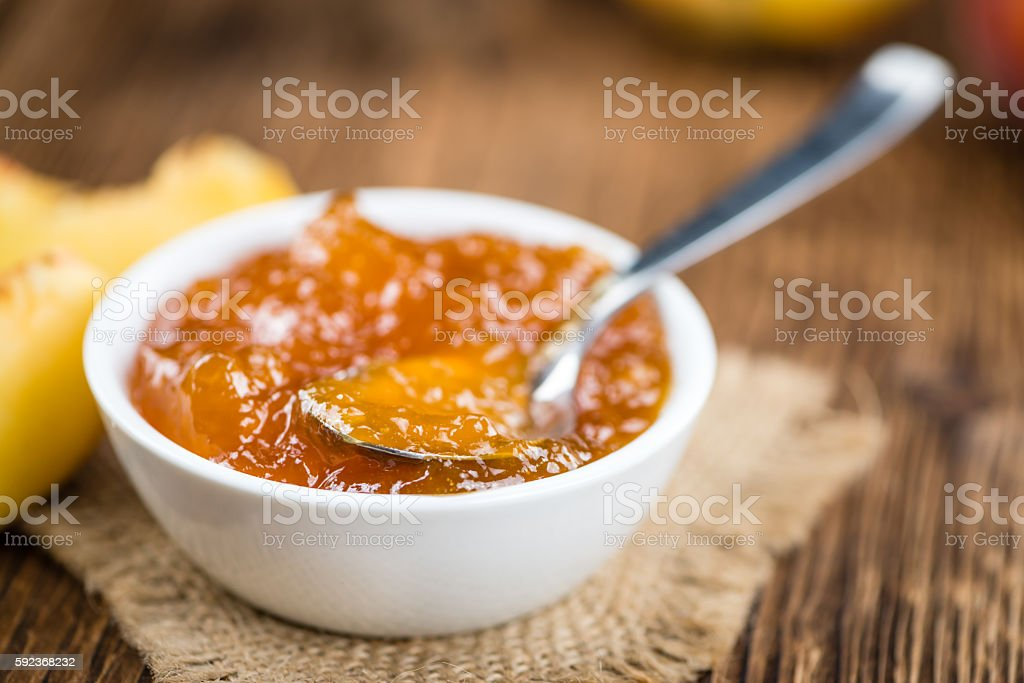 Wooden table with Peach Jam stock photo