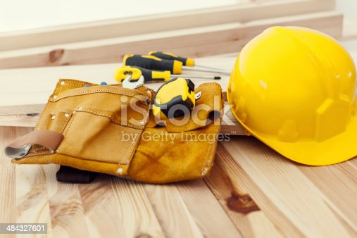 istock Wooden table with work tools and helmet 484327601