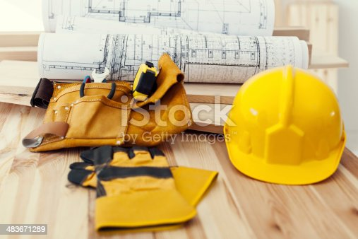 istock Wooden table with work tools 483671289
