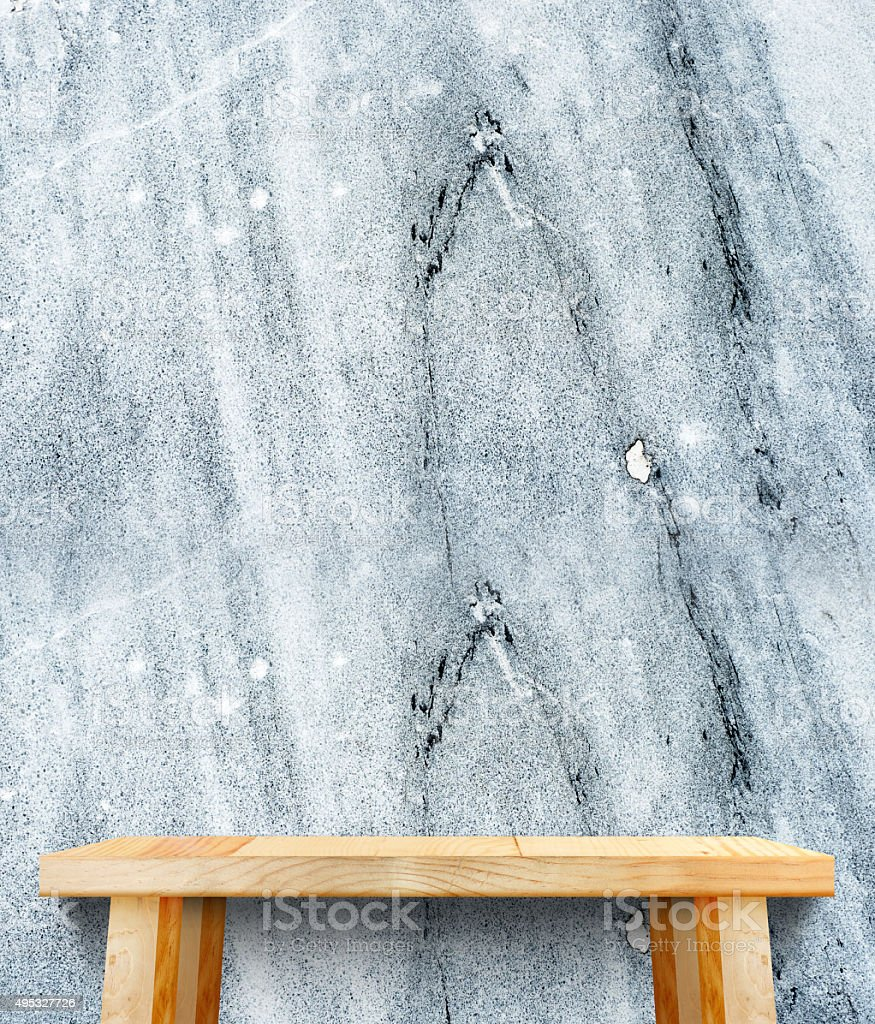 wooden tabletop at stone walltemplate mock up for display stock