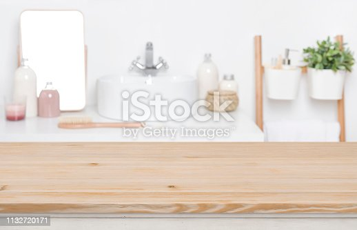 819534860istockphoto Wooden tabletop for product display over defocused bathroom interior background 1132720171