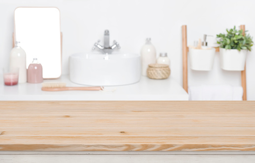 819534860 istock photo Wooden tabletop for product display over defocused bathroom interior background 1132720171