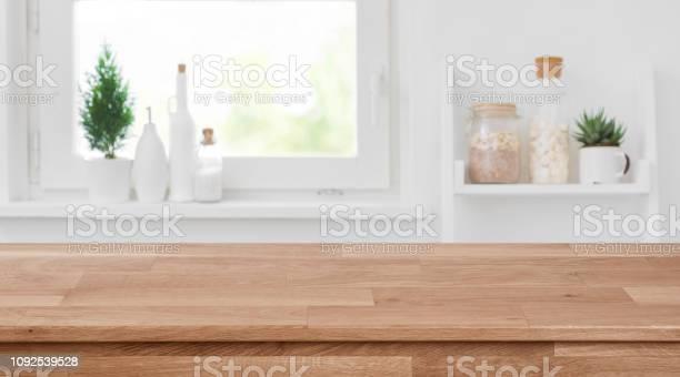 Wooden tabletop in front of blurred kitchen window shelves background picture id1092539528?b=1&k=6&m=1092539528&s=612x612&h=gymscihqmob1fgaf3mqnqrtp4kgml1uqnavie4ffydo=