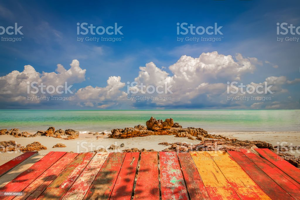 wooden tabletop with beautiful nature beach and blue sky background royalty-free stock photo