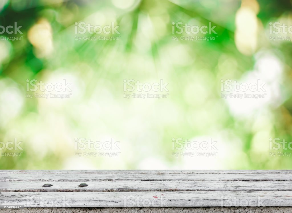 wooden tabletop with fresh green nature background royalty-free stock photo