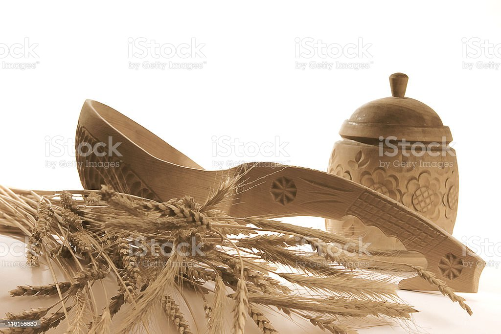 wooden tableware and goldish stems royalty-free stock photo