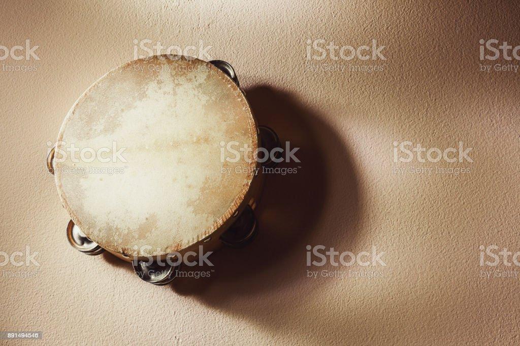 Wooden Tambourine on Wall stock photo