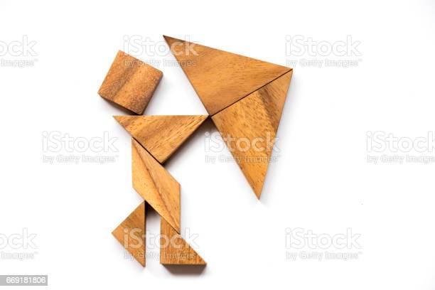 Wooden tangram as man hold umbrella shape on white background picture id669181806?b=1&k=6&m=669181806&s=612x612&h=hopsahph2skhnplse3zgg6ekecqqmix1dupa cauhuq=