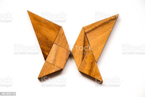 Wooden tangram puzzle in butterfly shape on white background picture id801855718?b=1&k=6&m=801855718&s=612x612&h=nu7v7kfrzqqbev otbfdlyhd6p2nhwyaq1fucr5fbgi=