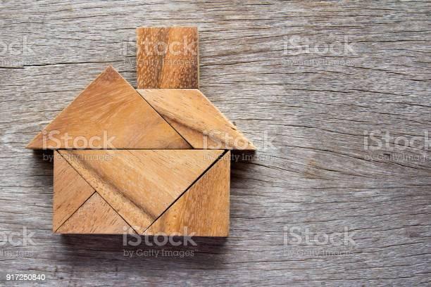 Wooden tangram puzzle in home shape for dream home or happy life picture id917250840?b=1&k=6&m=917250840&s=612x612&h=fnbndv61a eypzsb8b0b7za1k1d42ot7c8raqkpombo=