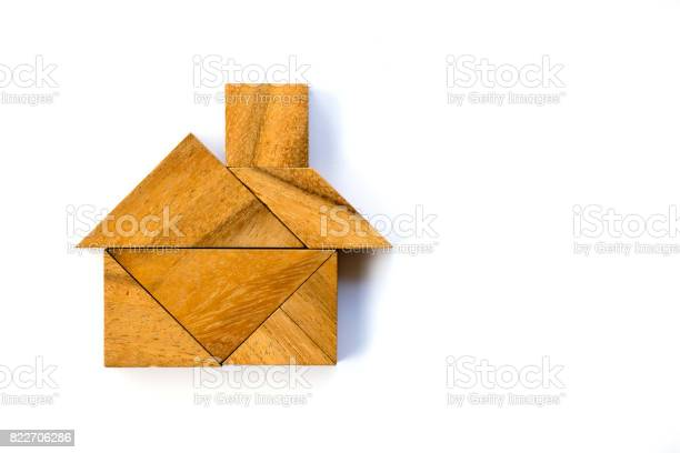 Wooden tangram puzzle in home shape on white background picture id822706286?b=1&k=6&m=822706286&s=612x612&h=g2t17tchcjgda06srspooddlvp1azk5eb7hnuzhehi8=
