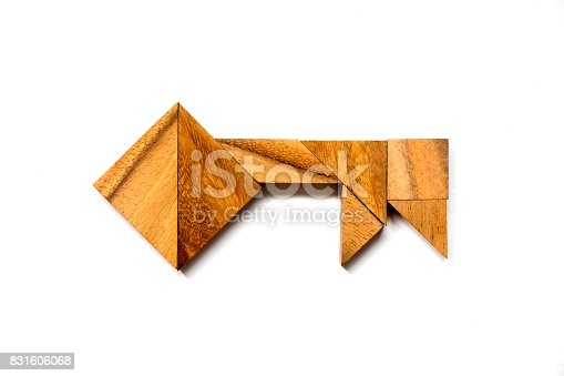 istock Wooden tangram puzzle in key shape on white background (Concept of data security, aothurized access, safety) 831606068