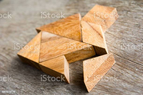 Wooden tangram puzzle wait to fulfill home shape for build dream home picture id692373776?b=1&k=6&m=692373776&s=612x612&h=xji6buxqlnsxsa16qp3 wy apsvarczgnc79tiv8h e=
