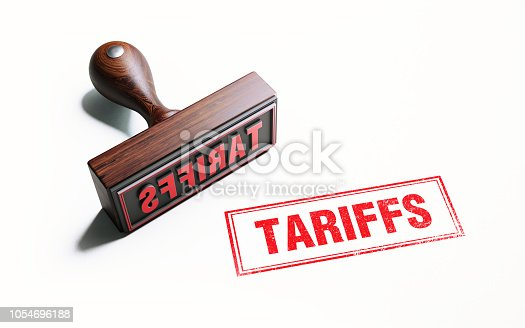 Wooden tariffs stamp on white background. Horizontal composition with copy space.