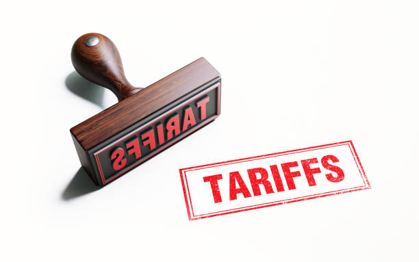 Wooden Tariffs Stamp On White Background stock photo