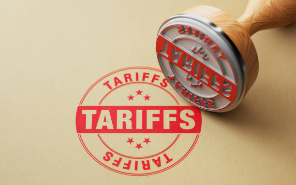 Wooden Tariffs Stamp On White Background Wooden tariffs stamp on white background. Horizontal composition with selective focus and copy space. tariff stock pictures, royalty-free photos & images