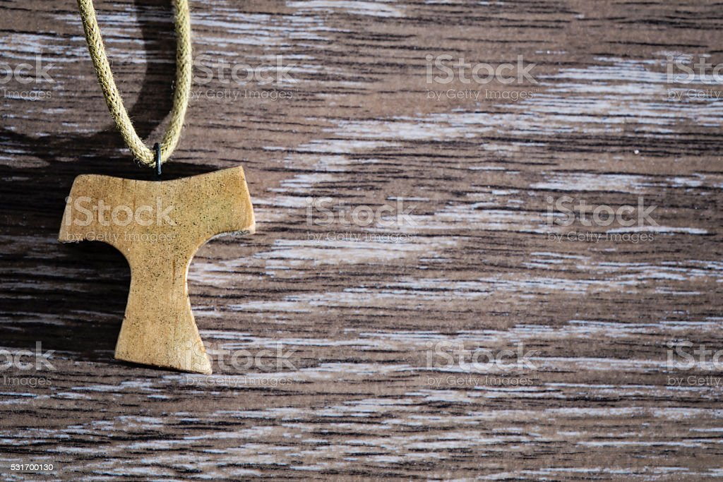Wooden Tau stock photo