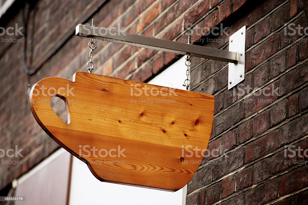 Wooden Tea cup sign stock photo