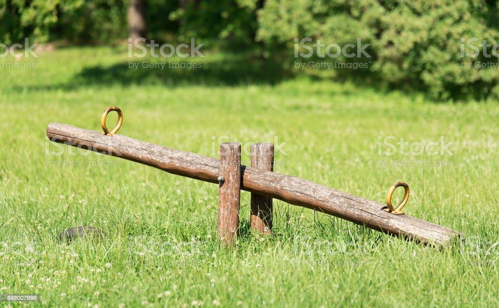 Wooden teeter in park stock photo