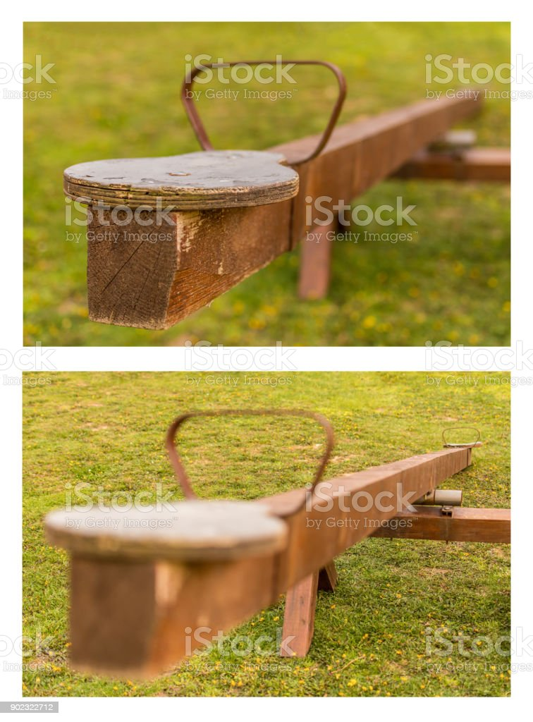 wooden teeter totter from two frames stock photo