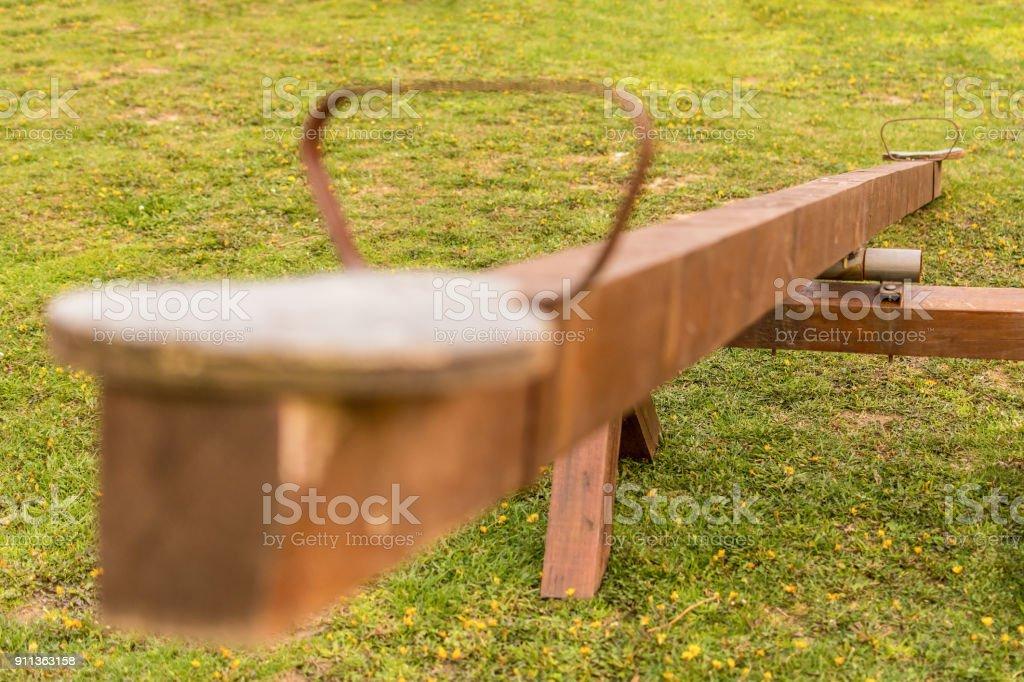 Wooden teeter totter stock photo