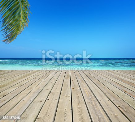 Wooden terrace and tropical seascape