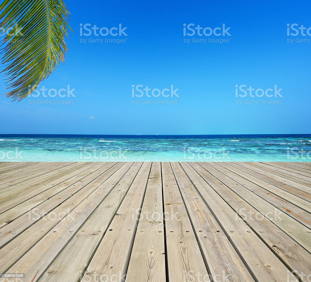 Wooden terrace and tropical seascape stock photo