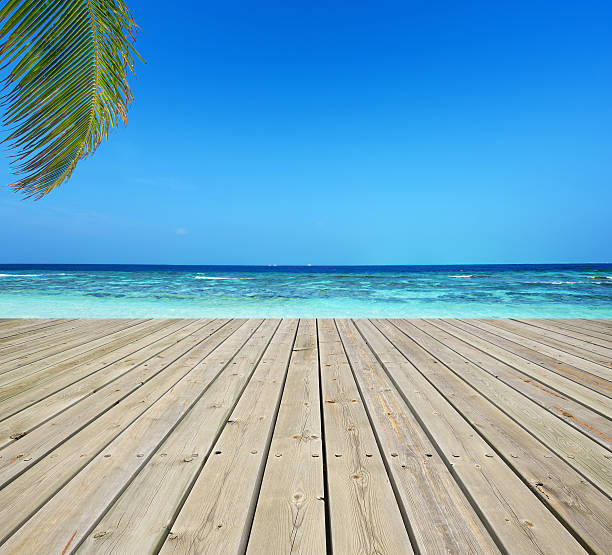 Wooden terrace and tropical seascape Wooden terrace and tropical seascape boardwalk stock pictures, royalty-free photos & images