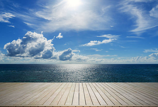 wooden terrace beside tropical sea - pier stock photos and pictures
