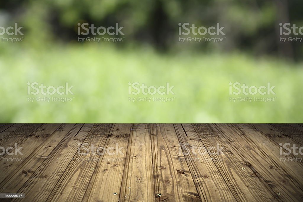 Wooden terrace park view backdrop stock photo
